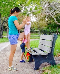 mom exercising with a baby in the park